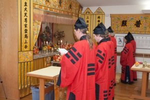 Chanters in red robes at Tallahassee Taoist shrine