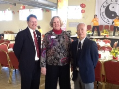 Workshop leaders Sean Dennison, Karen Laughlin and Tony Kwong wait to greet the guests for the Grand Opening celebrations